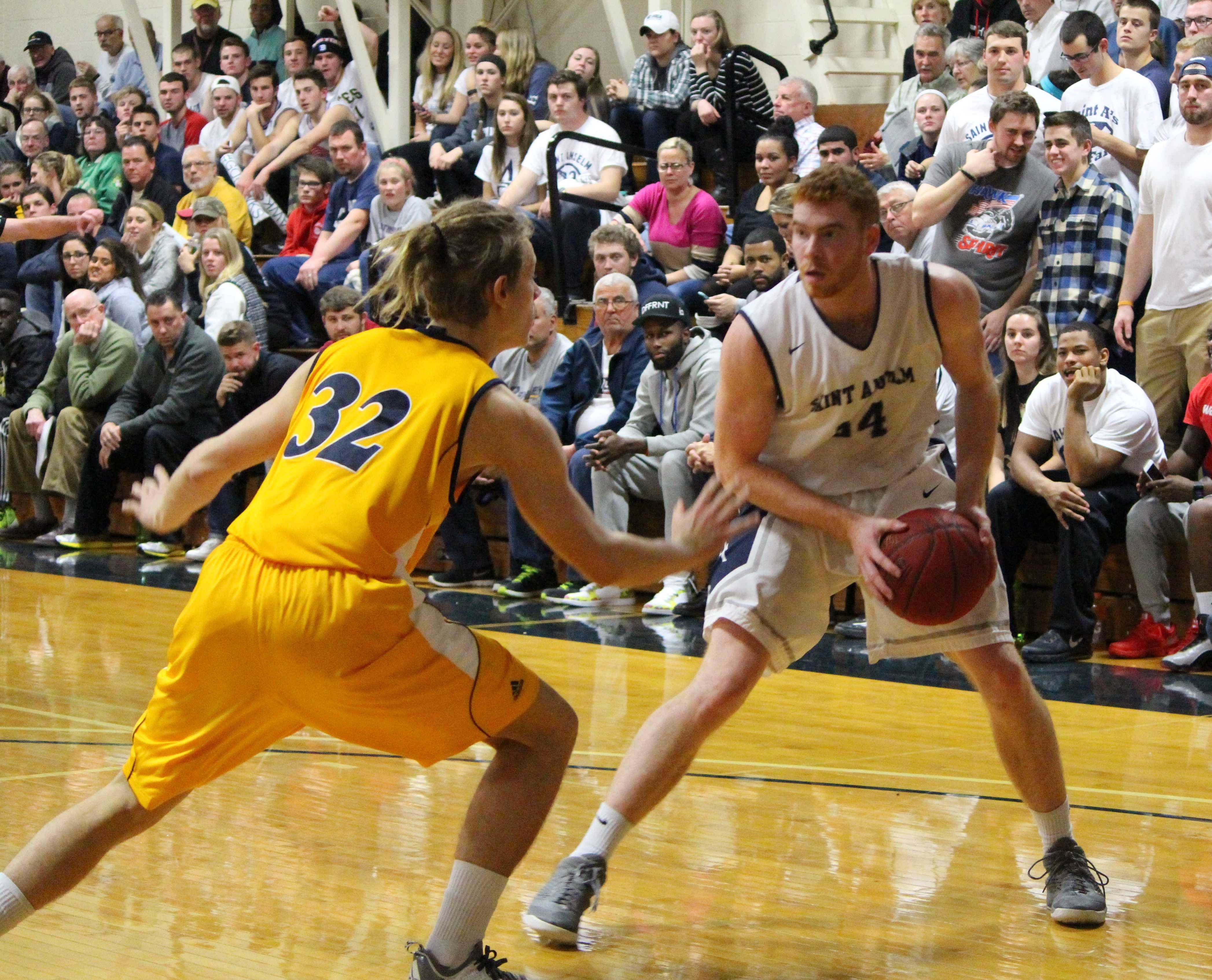 Harrison Taggart on the court for St. A's during the season opener against SNHU.