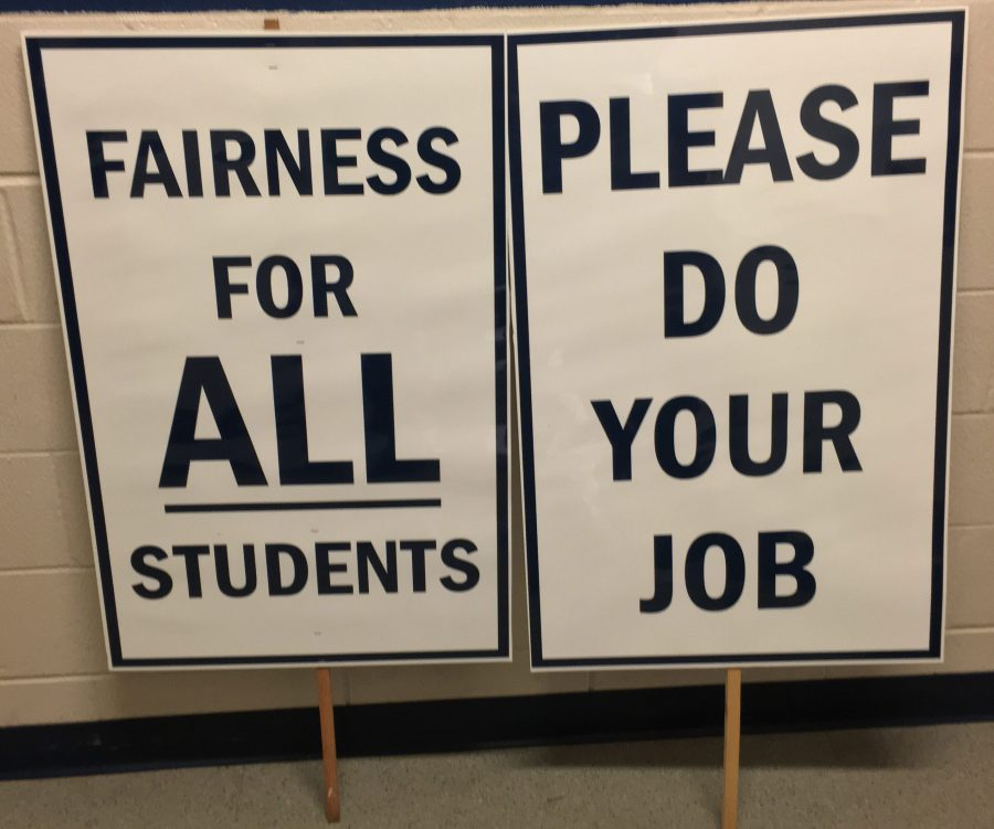 Signs+used+by+St.+A%E2%80%99s+varsity+ice+hockey+protesters.