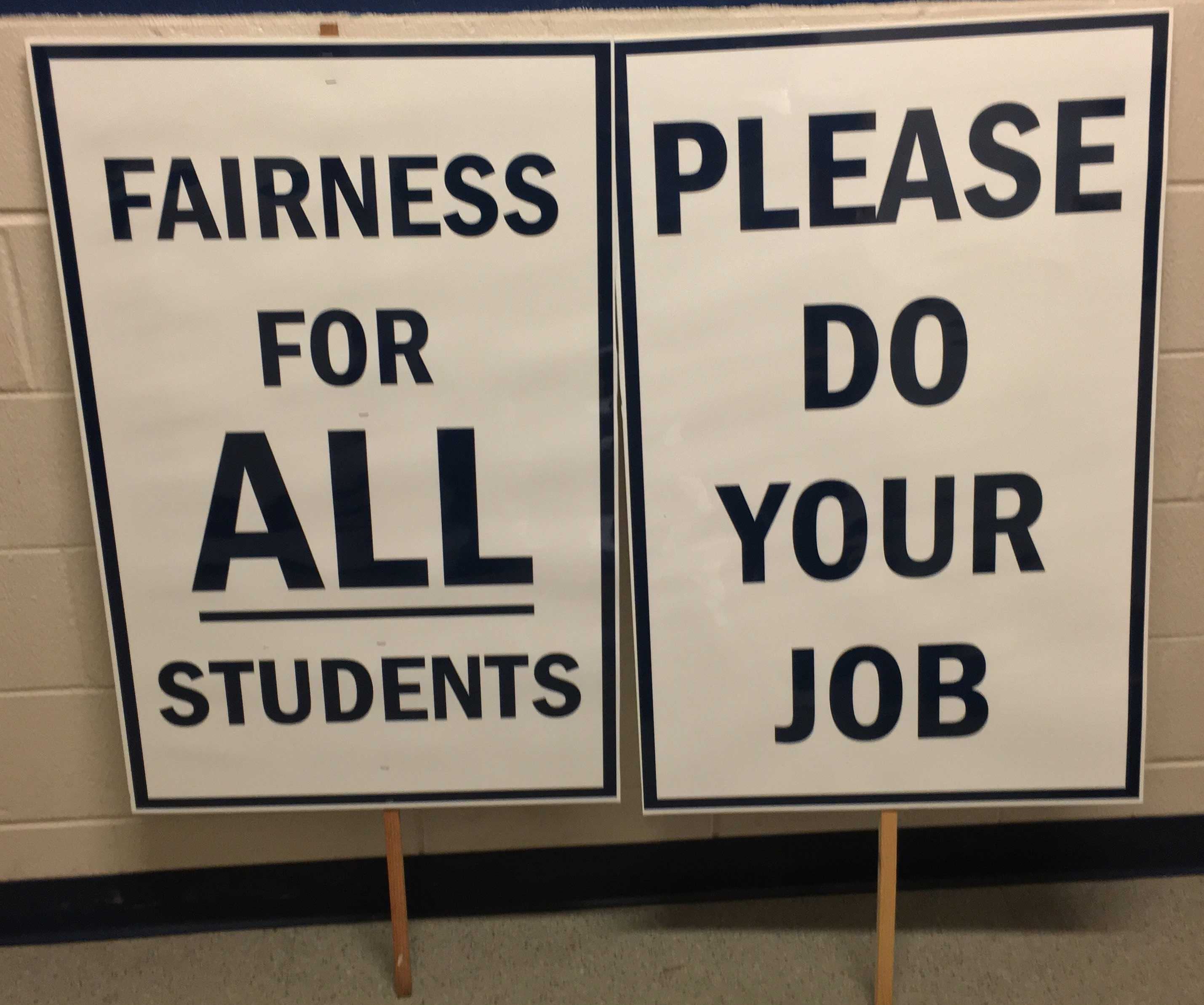 Signs used by St. A's varsity ice hockey protesters.