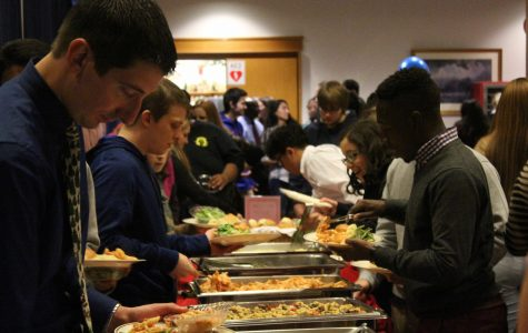 College community gathers at intercultural holiday dinner