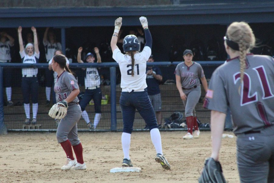 Sophomore+Jordan+O%E2%80%99Connor+looks+to+her+teammates+as+she+celebrates+her+on-base.