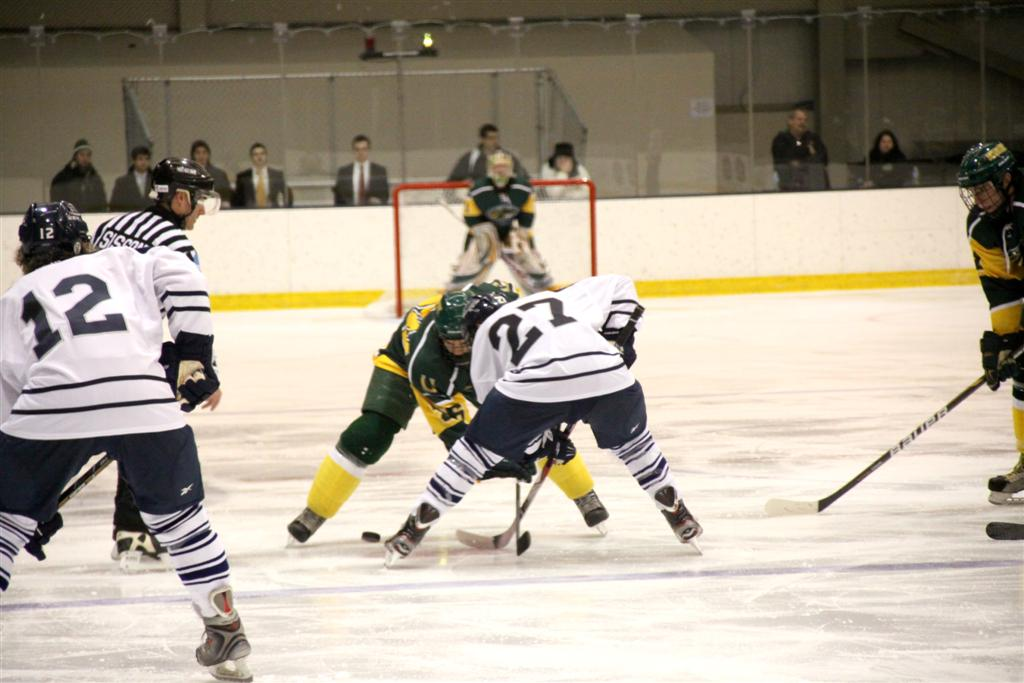 From left: Bryan Sullivan '16 and Joey Agliato '15 battle it out with their opponent on the ice.