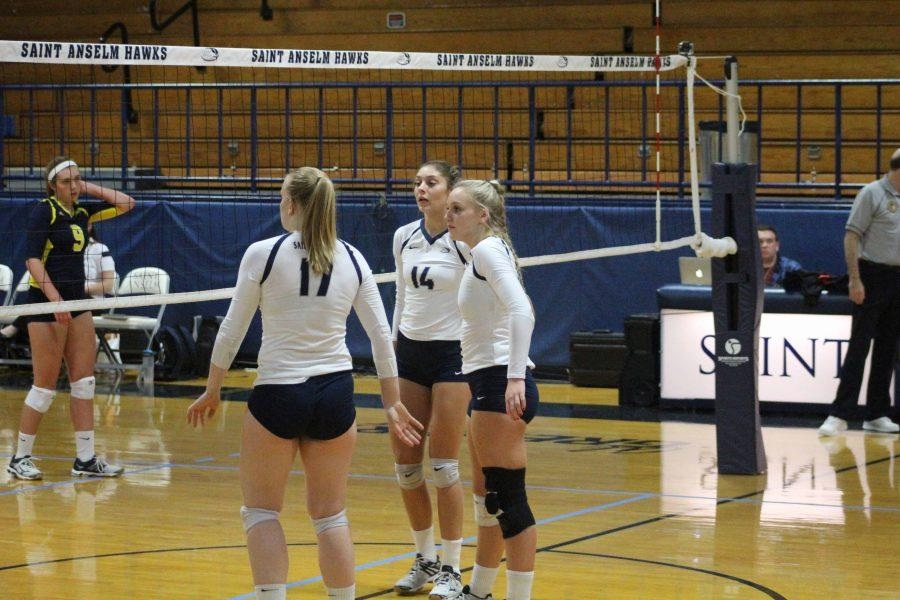 Katy Teets, Amanda Williams and Jewel Hays all waiting a serve from SNHU Oct. 4.