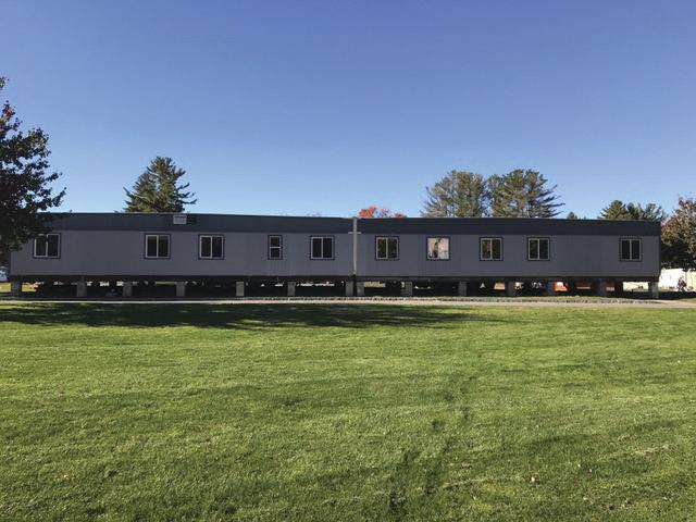 The new modular unit in front of Holy Cross Hall.