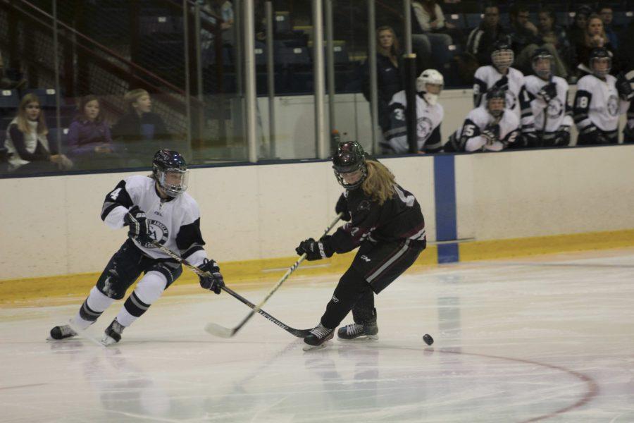 Sophomore Sara McNamara looking for a loose puck in team's opener on Oct 28.