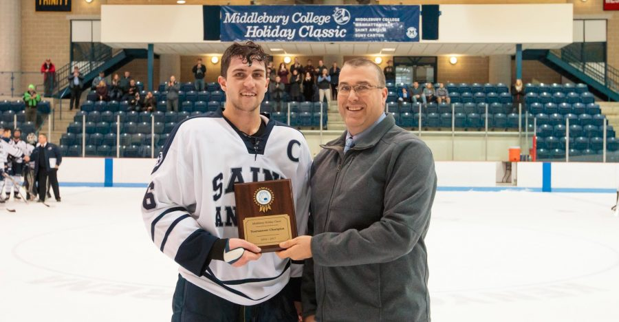 Lawrence+Taylor+IV+%2717%2C+captain+of+Hawk+men%27s+ice+hockey%2C+receiving+the+championship+plaque.+