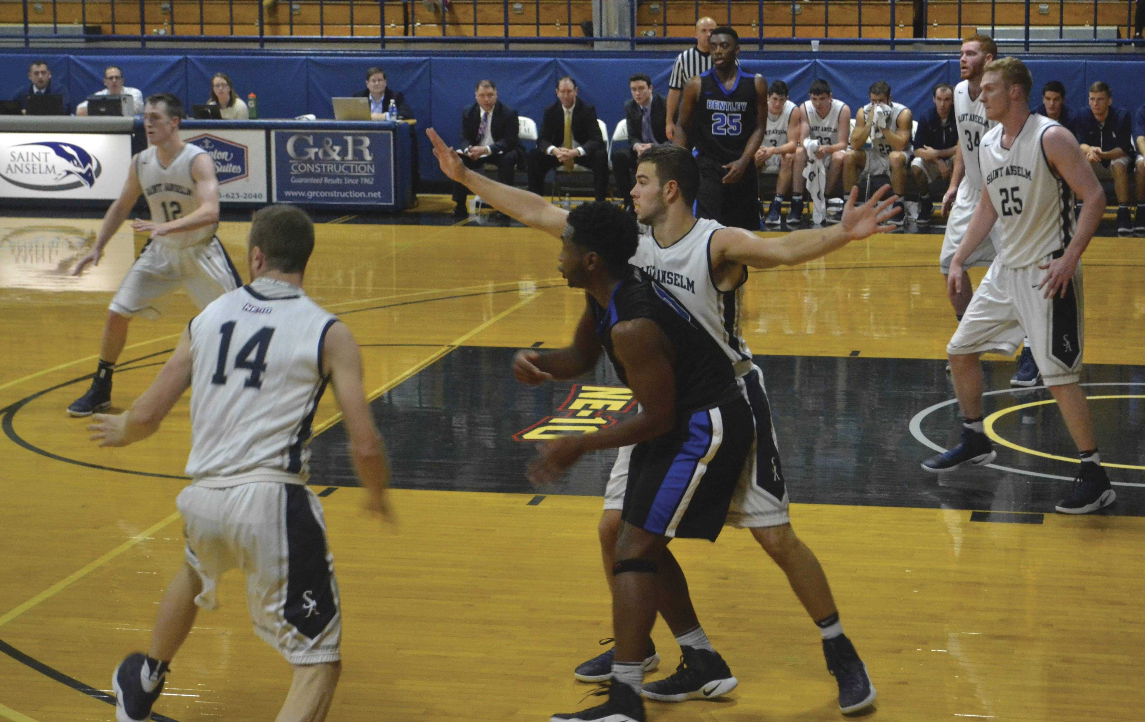 Men's basketball running an offensive play in a victory against Bentley Nov. 30.