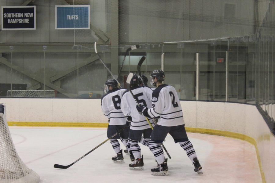 Brendon Kerrigan, Joey Harrington, Dave Almeida on the ice in the Hawks victory.