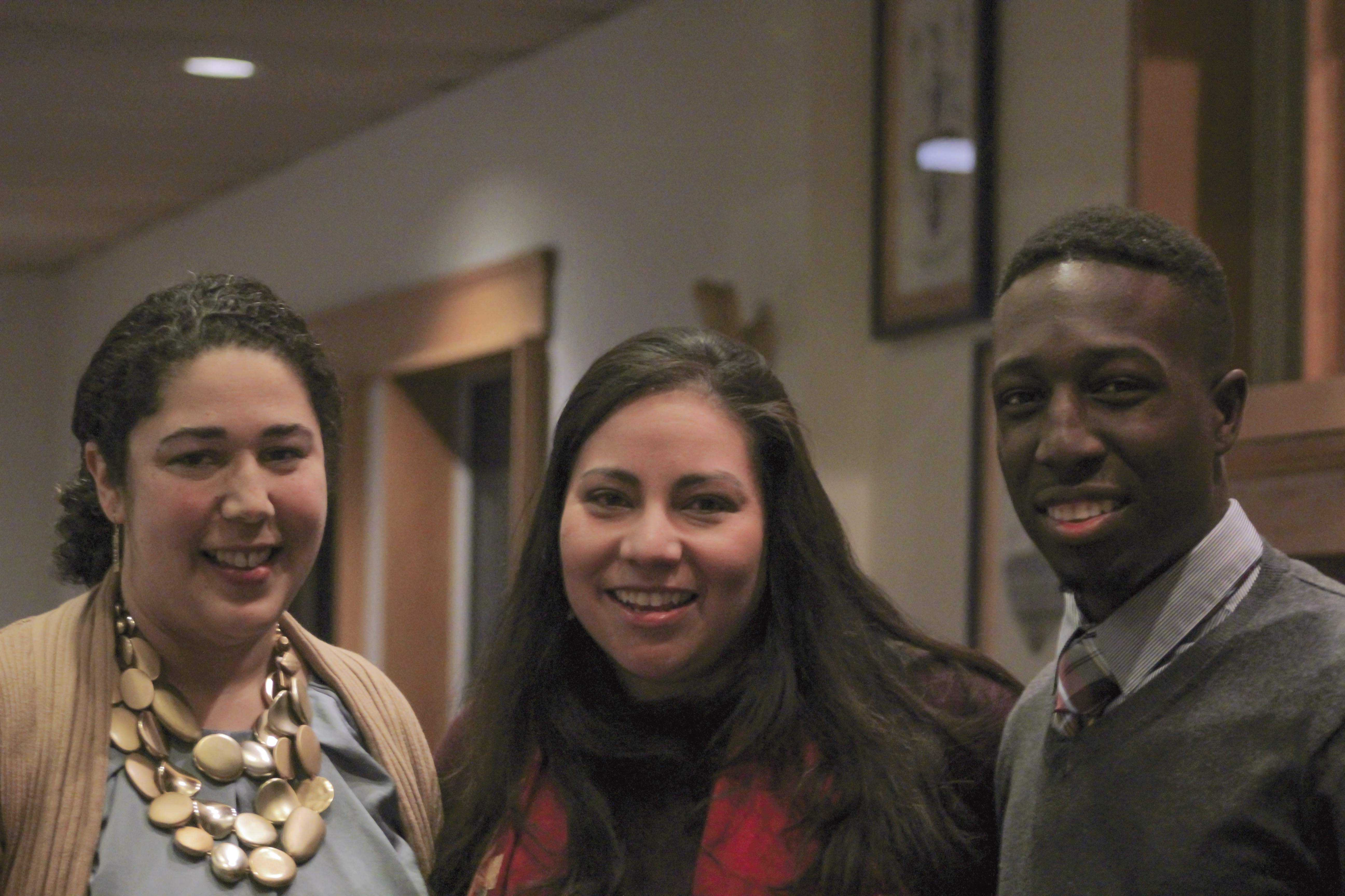 Linda Rey (center) presents Social Justice Award to Stokes '17 (right) and Professor Brady '99 (left).