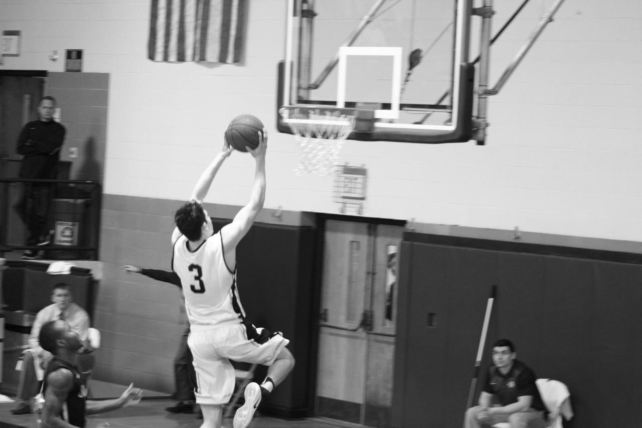 Sophomore Cody Ball as he moves to dunk the ball.