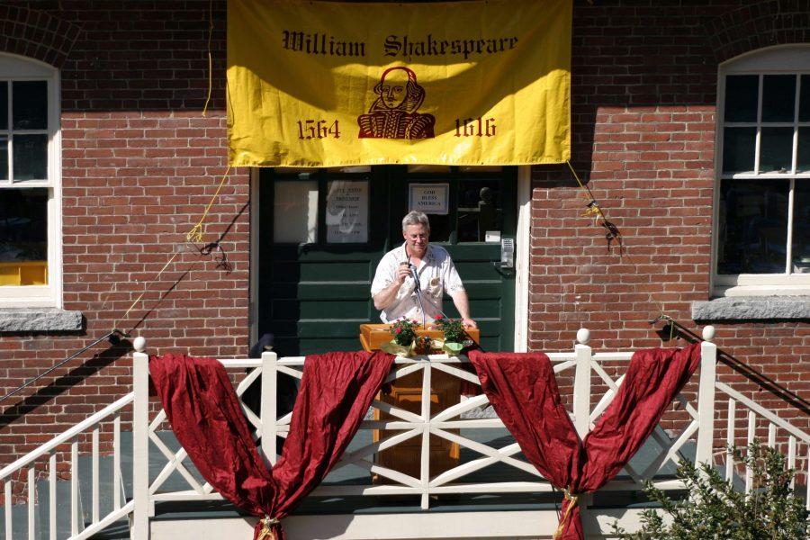 Professor Gary Bouchard reading sonnets behind Alumni Hall.