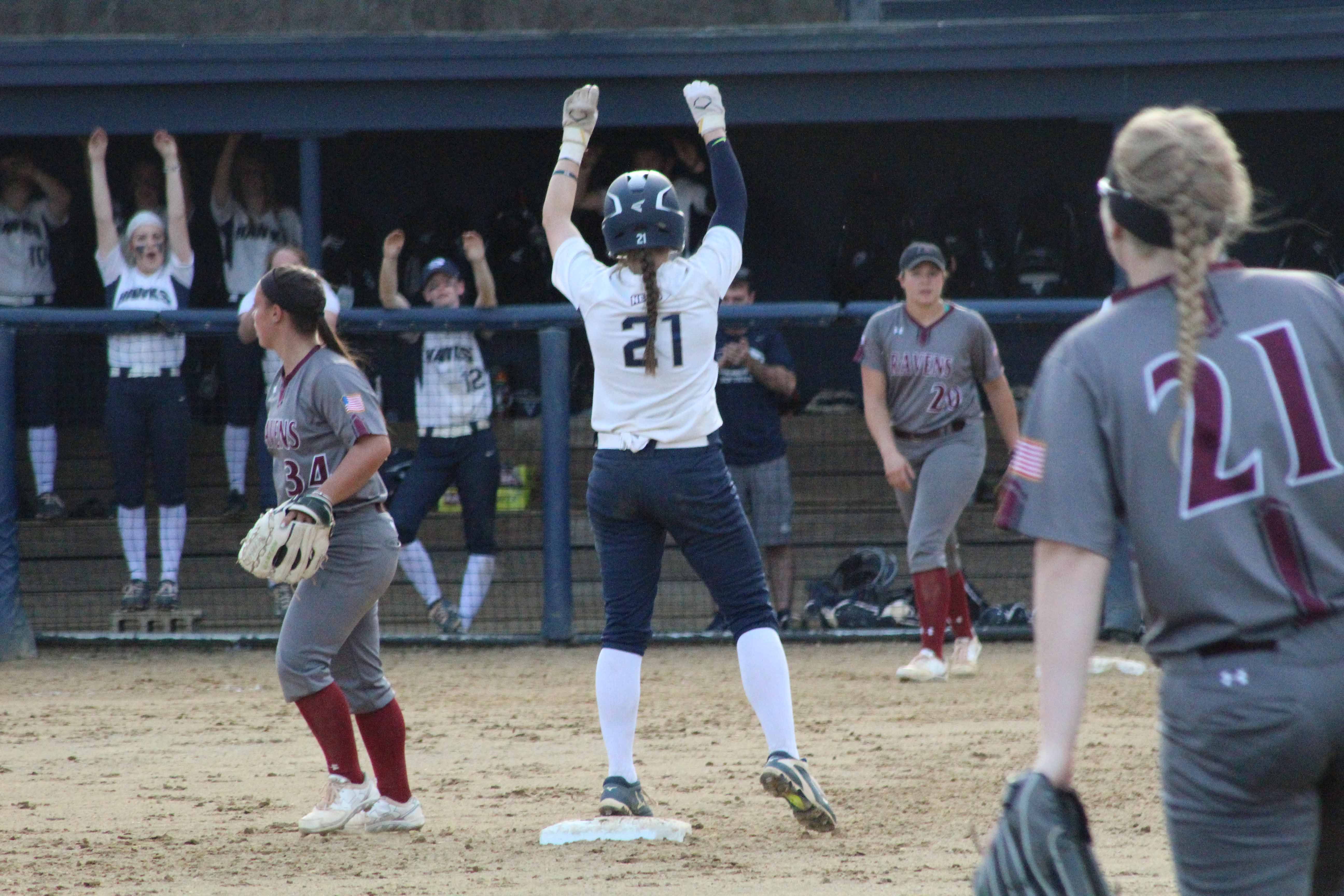 Sophomore Jordan O'Connor looks to her teammates as she celebrates her on-base.