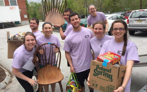 Students prepare to deliver food, clothing, and furniture to families in need