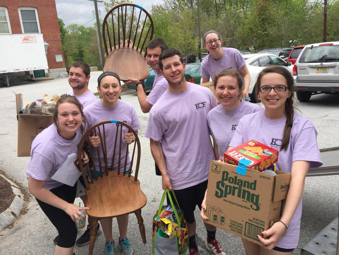 (Left to right): Amy Vachon '17, Charles Dooley '16, Madison Vigneault '18, Josh Post '16, Paul Trabucco '16, Amelia Way '16, Mar- garet Lynch '17, and Jessica Gipson '16 at the 2016 Food, Clothing, & Furniture drive.