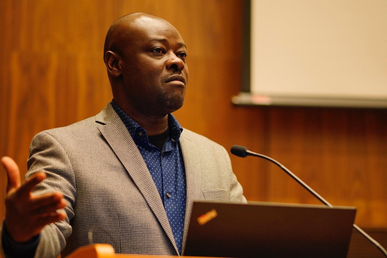 Professor Helon Habila speaking in the Jean Student Center Complex Auditorium.