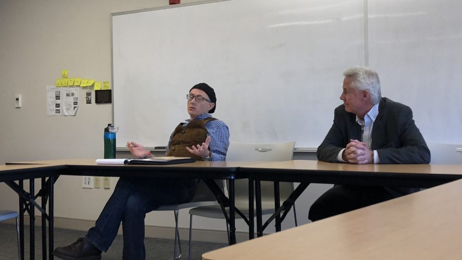 Professor+Bouchard+%28right%29+listens+intently+as+Professor+Durham+%28left%29+discusses+his+perspective+on+science+and+truth.