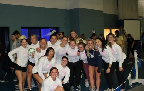 The women's ice hockey team smile as they participate in Saint Anselm College's 12th annual Sister Pauline Lucier Relay for Life on Friday, March 29