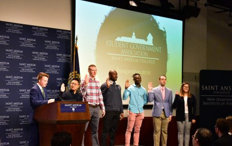 From left to right: Student body VP Jacob Ethier swears in the governing class of 2020: Secretary Sean Connor, Senator Tom O'Hare, President Jerome Seglah, VP Farid Mawanda, Senator Jeremy gait, and Senator Caroline Ihlefeld (ED FRANKONIS/CRIER)