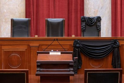A black ribbon is draped over Justice Ginsburg