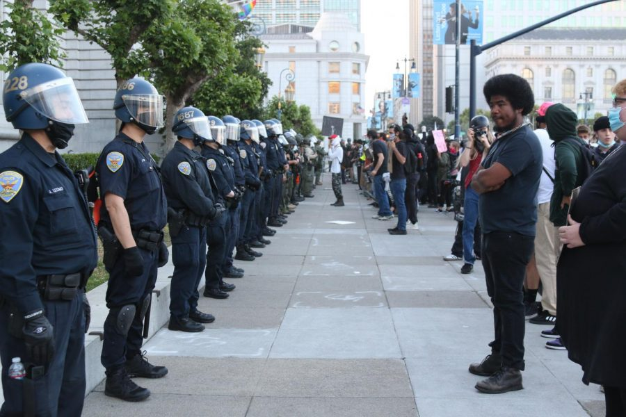 A group of protestors in San Francisco face off with police in the wake of George Floyds death.