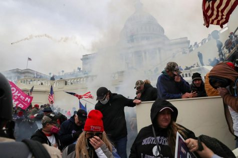 Tear gas explodes as Trump supporters force their way into the U.S. Capitol on Wednesday.