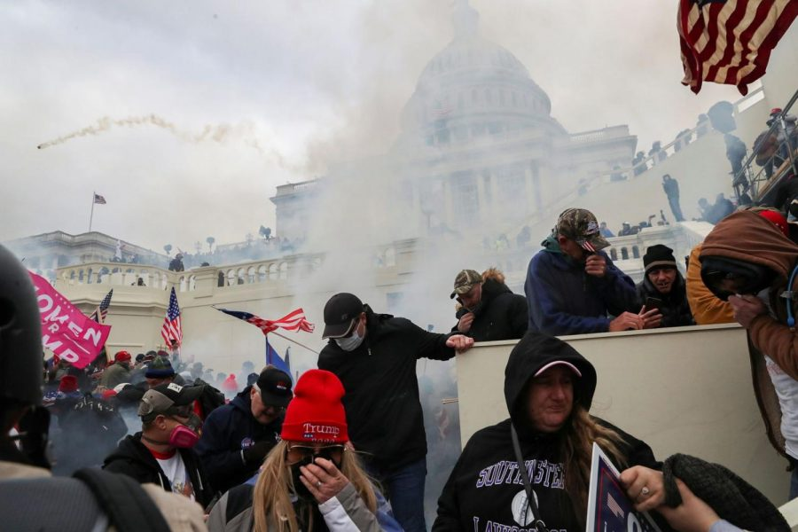 Tear+gas+explodes+as+Trump+supporters+force+their+way+into+the+U.S.+Capitol+on+Wednesday.