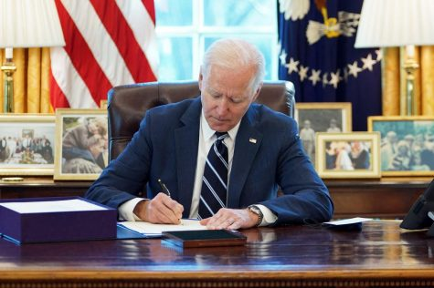 President Biden signs the Covid-19 relief package on March 11, 2021.