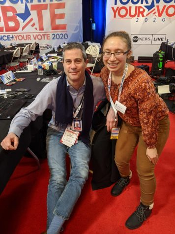 News Editor Janelle Fassi 21 posing with journalist Paul Steinhauser at the February 2020 First in the Nation debates.