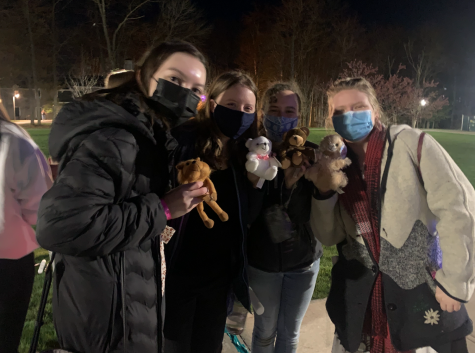 Students wearing masks at socially distanced Spring Weekend