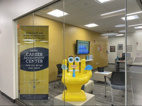 Hand-shaped chair smiles at students from the Career Development Center window in the student center