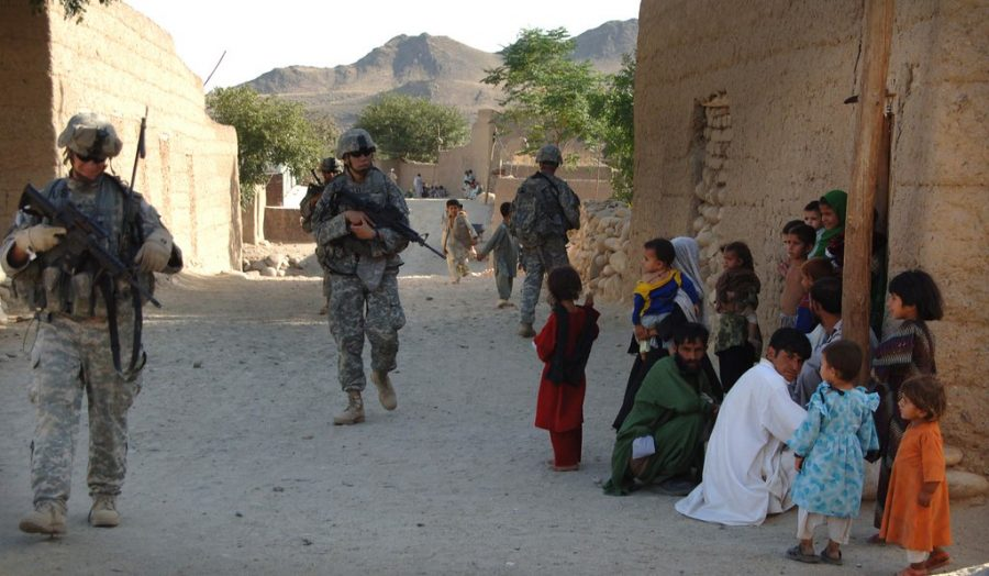 U.S. Army soldiers march through Afghanistan